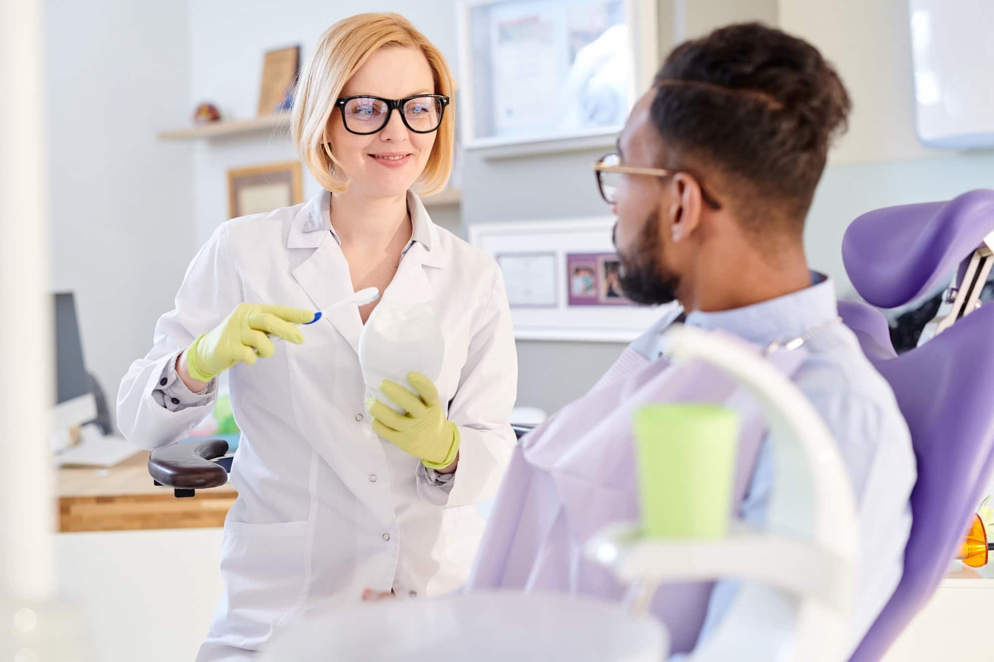 Female Dentist Explaining Hygiene Rules