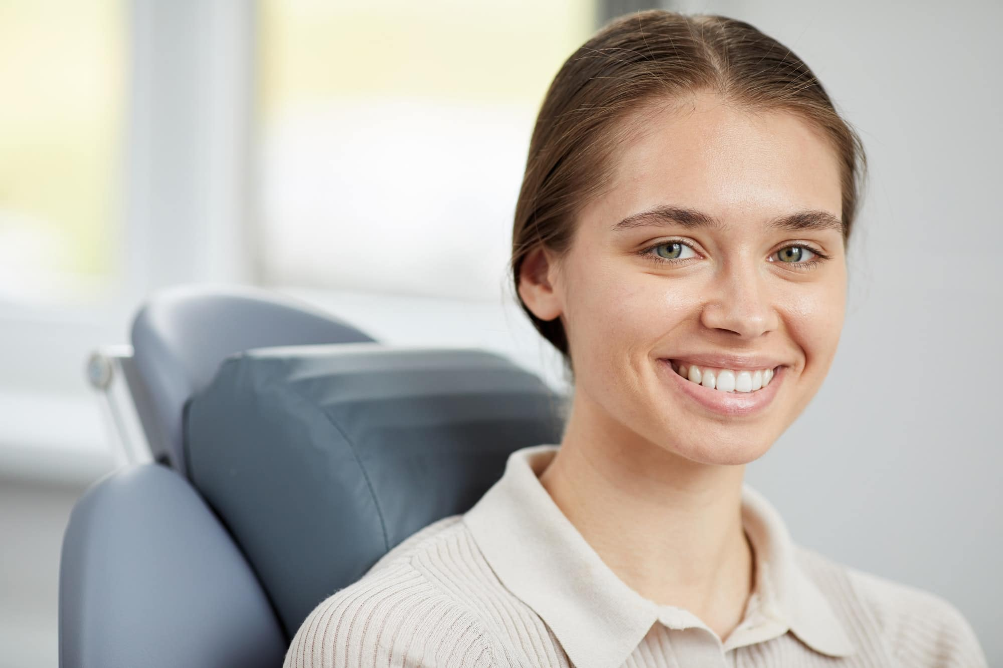 Pretty Young Woman in Dental Chair